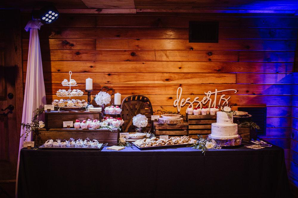 Cake cutting and dessert table at Millikan Farms wedding | Kayli LaFon Photography