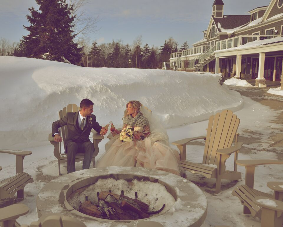 Bride and Groom Sit on Snowy Wedding Day at Whistle Bear Golf Club
