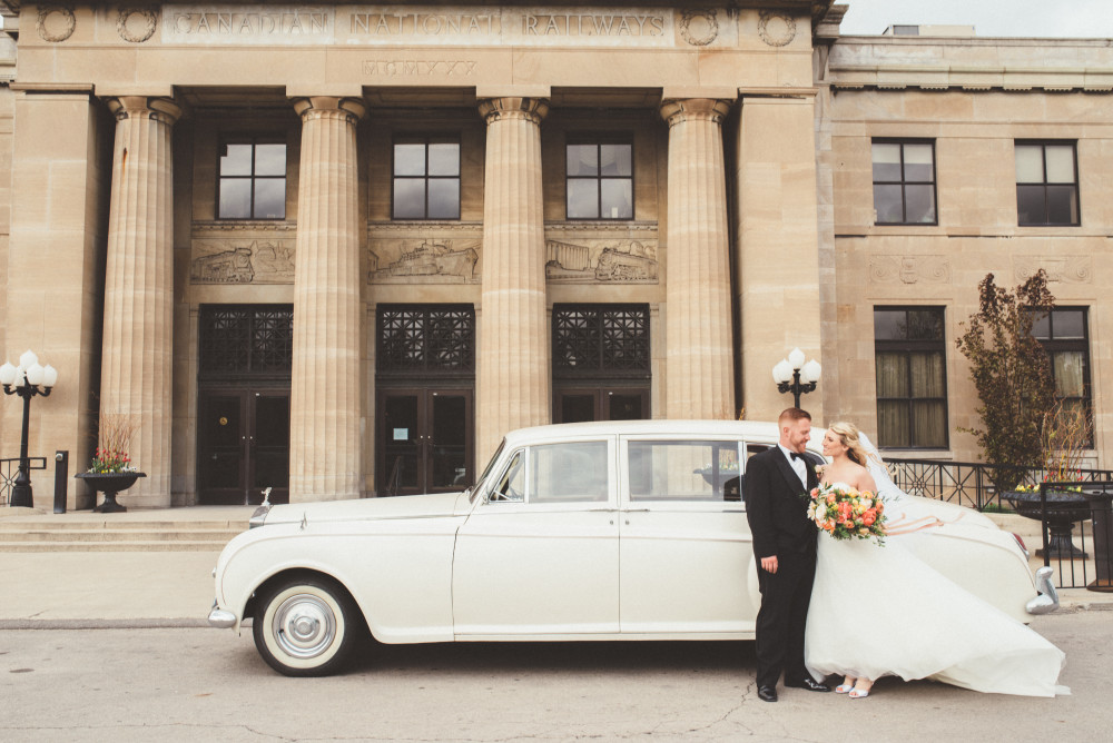 Bride and Groom in front of Car at Liuna Station