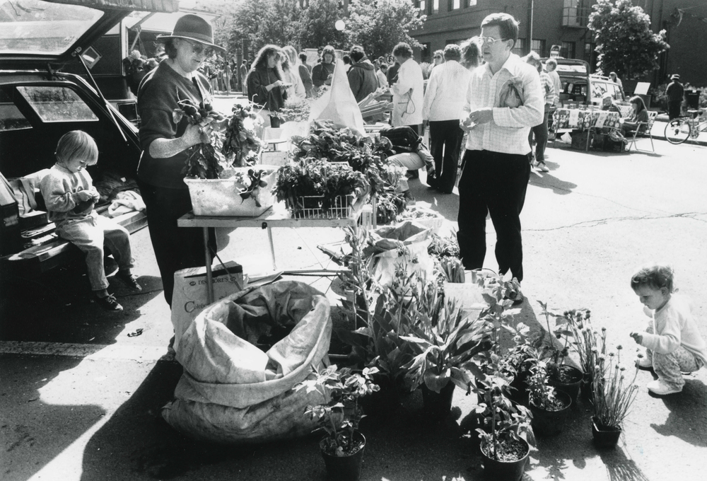 In this historic photo from June 2, 1990, Bob Bolin buys veggies from Kris McRae in Friendship Square. Photo courtesy of the Latah County Historical Society (1-02-119)