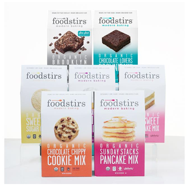 """- Foodstirs Baking MixesFoodstirs' mission is to """"stir up the food industry with a revolutionary baking line"""". They believe that all the ingredients in their baking mixes must be clean, sustainable and equitable. The ingredients are organic and never genetically-modified, so the flavors are true and vibrant. These include fair trade chocolate and cocoa; biodynamic cane sugar; heirloom flour; and chemical-free coloring agents. They choose planting methods that keep the soil healthy and enrich the land. And they source from small farms that value their employees. With only six steps from opening the box to taking the finished product from the oven, Foodstirs mixes are a simple way to enjoy a home-baked treat. Look for five flavors in the baking set: gingerbread, chocolate brownie, sugar cookie, chocolate chip cookie and vanilla cake."""
