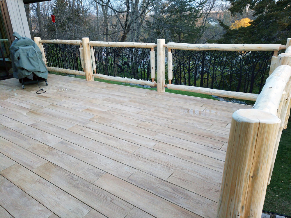 Cedar Log Railing with Decorative Metal Panels by Soderlund's Woodmill in Chisago City, Minnesota