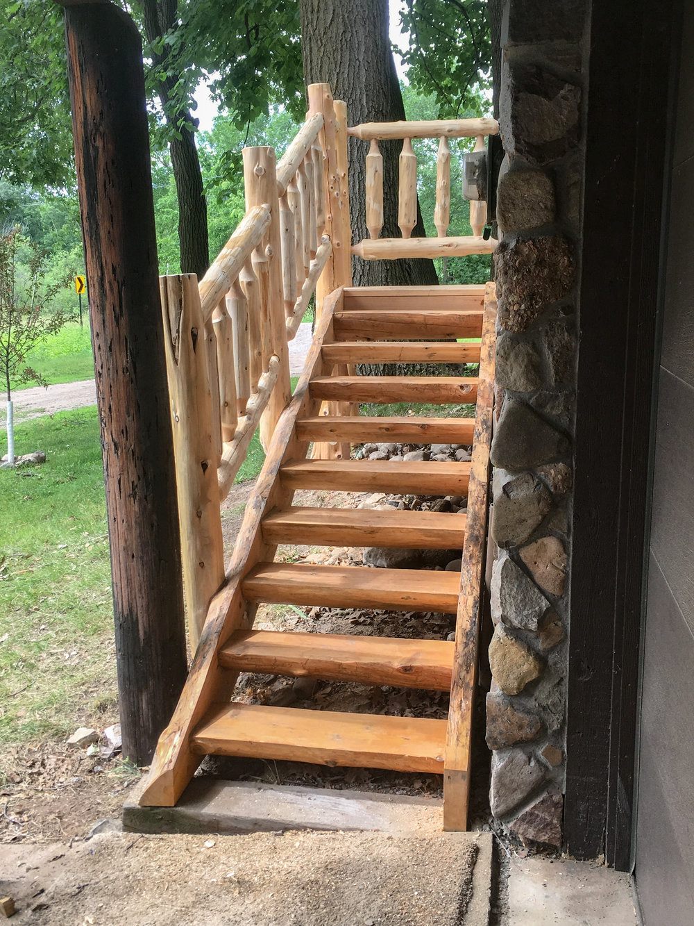 Cedar Log Railing and Stairs by Soderlund's Wood Mill in Chisago City, Minnesota