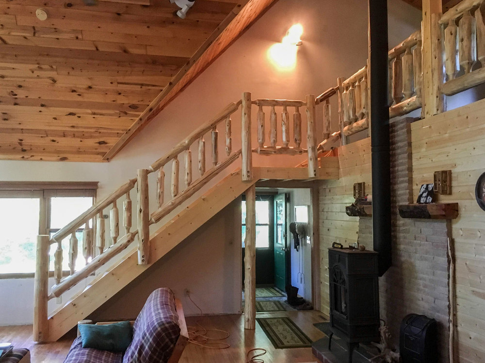 Interior Log Railing by Soderlund's Wood Mill in Chisago City, MN