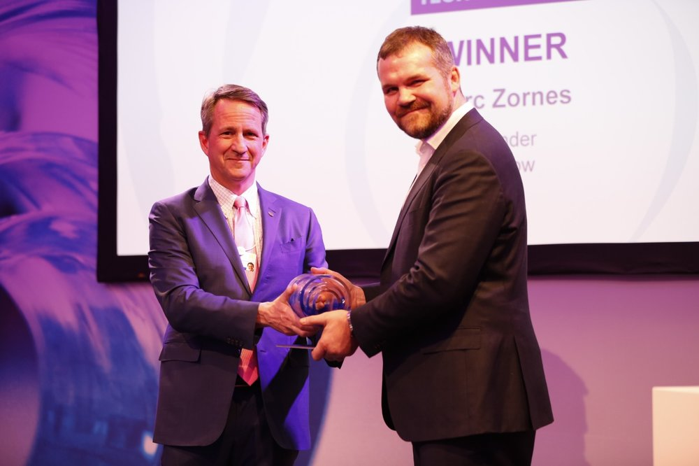Marc Zornes (right), Winnow co-founder and CEO, accepts the Circular Economy Tech Disruptor Award from Christophe Beck (left), Ecolab Executive Vice President and President of Global Industrial.