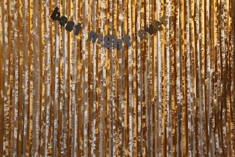 Gold and silver streamers combine for a shimmery and classy photo booth backdrop. // Jan. 2015