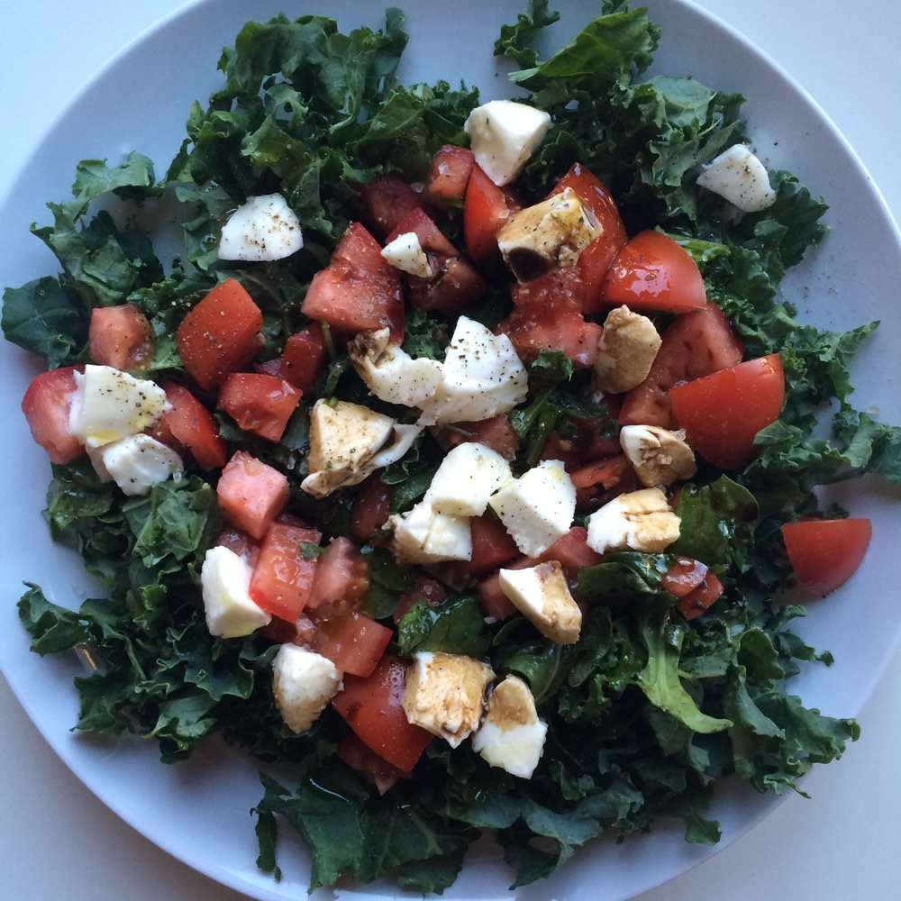 My summer salad. Kale, mozzarella, tomatoes, extra virgin olive oil, balsamic, sea salt and cracked pepper.