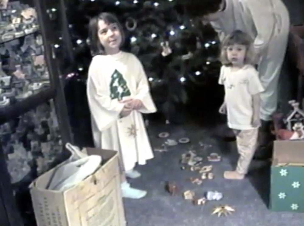 A screenshot from a home video of me and my sister decorating the tree with our Mom. My Dad was filming, and our baby (2 week old!) brother slept in the next room. That was our first Christmas as a family of five! <3