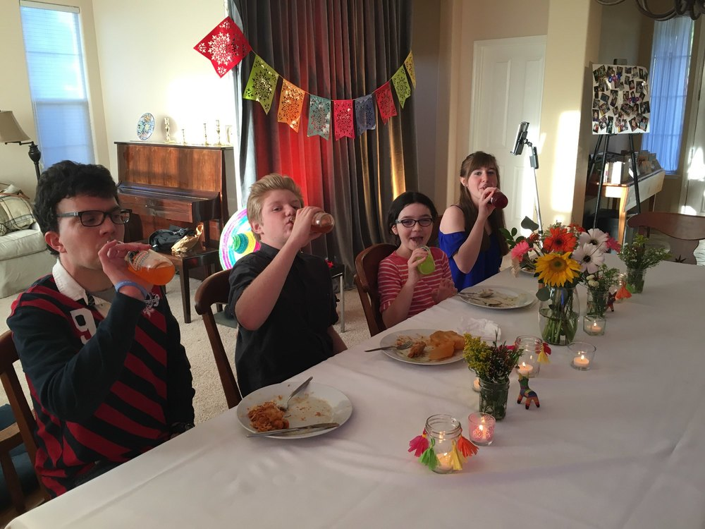 Some of my cute cousins enjoying Mexican sodas along with dinner.