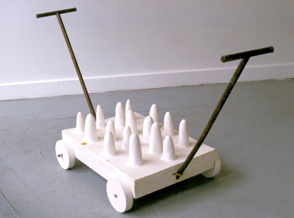 Futility Cart  , 1999 Cast hyrdrastone and copper 12 x 32 x 32 in. (30.48 x 81.28 x 81.28 cm)