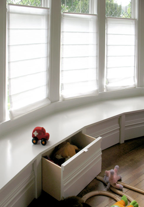 new bench seat following the big bay window, with concealed storage for kids'