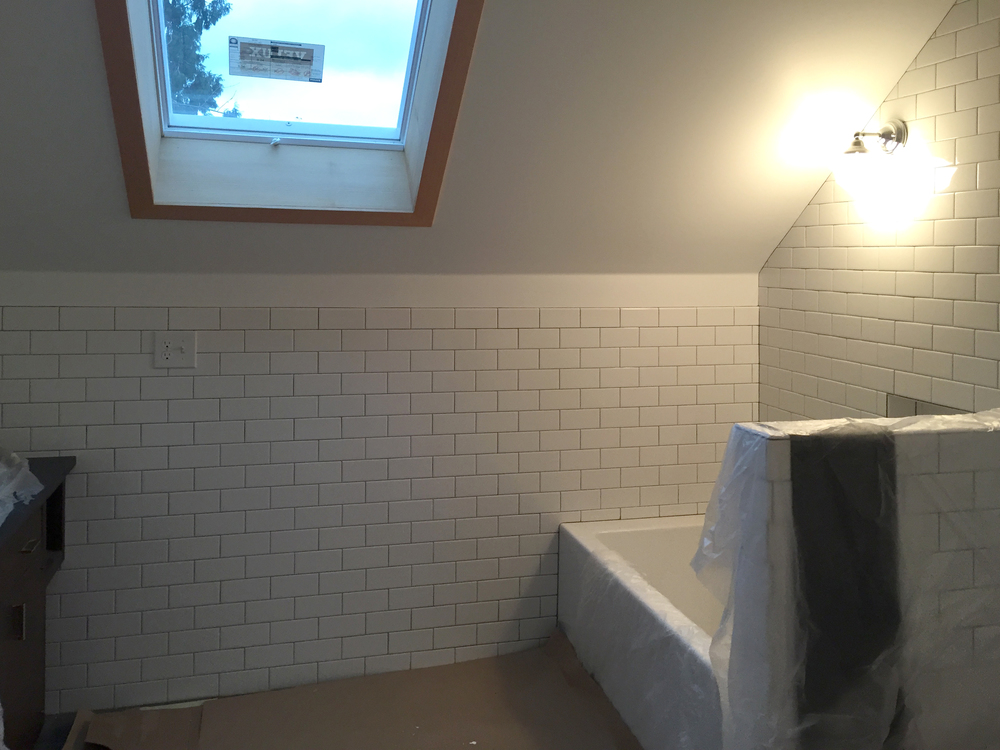 A new bathroom on the second story features a skylight and deep soaking tub.