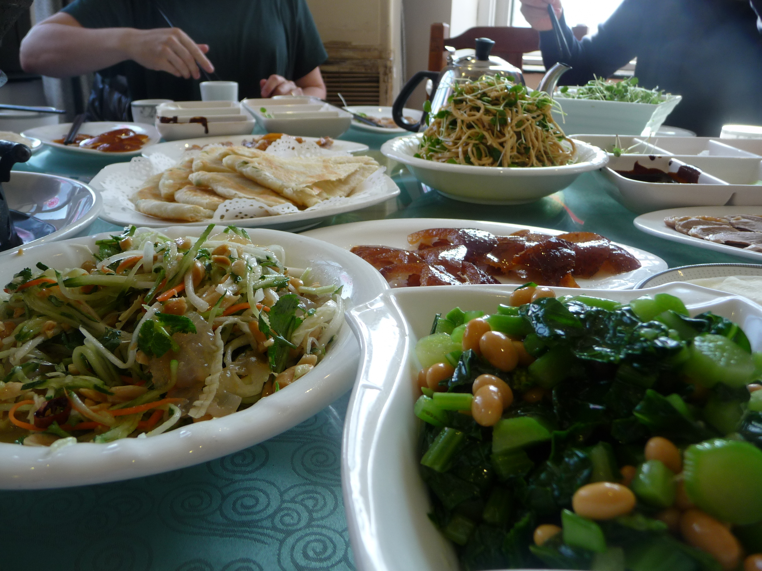 Peking duck and vegetable side dishes
