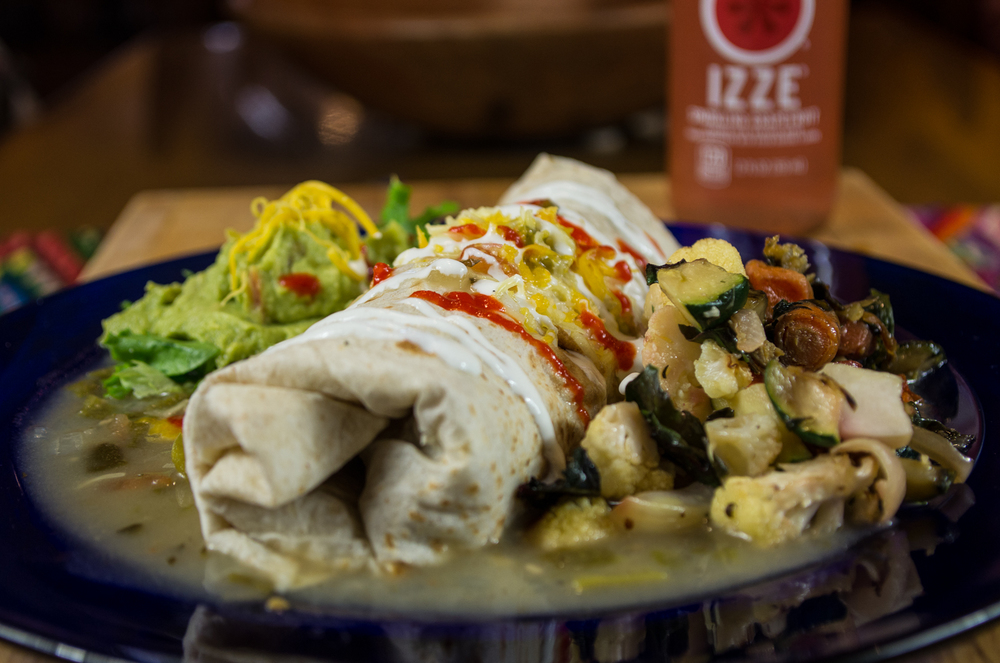 Burrito, green sauce with side of roasted vegetables