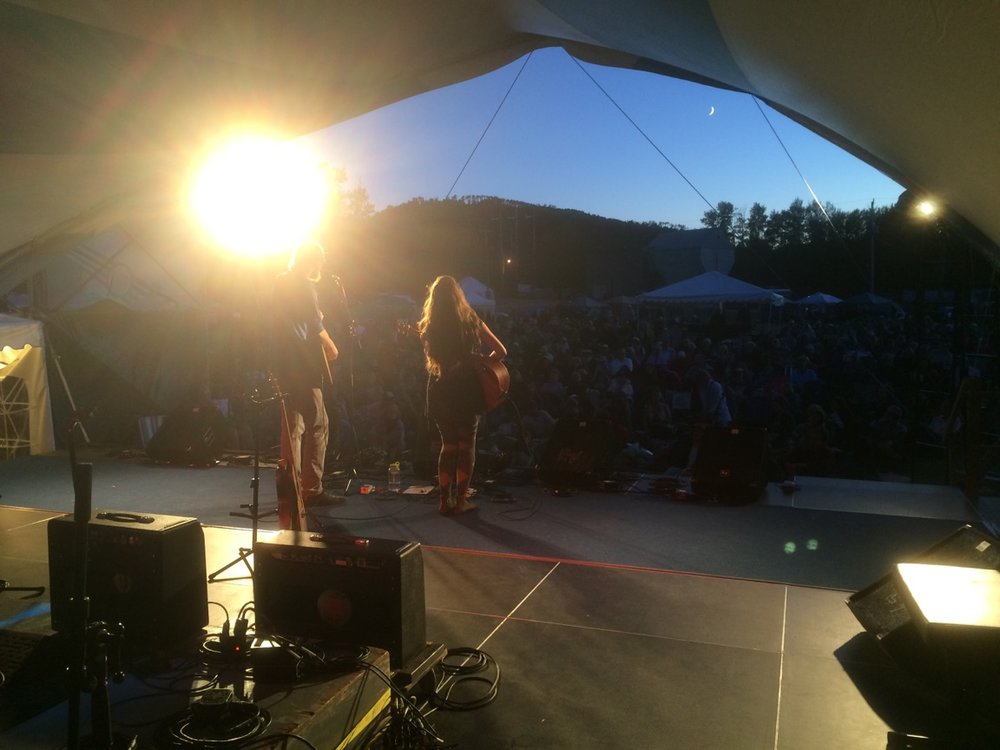 Playing during sunset on the Main Stage at Live From The Rock Folk Festival