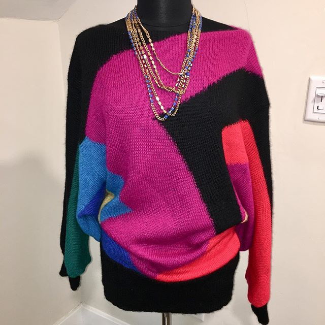 "NOW AVAILABLE: Vintage Mohair Colorblock Sweater/Dress, Size M-XXL. $50. Rare find!! Oversized mohair sweater in brilliant jewel-tone colors. Boatneck Style. Sleeves are large, dolman style with a zigzag/ sawtooth design underneath. Tag with brand and size are missing, however, the care tag is intact. This sweater can be worn as a top or a dress. Also, can be worn up to plus size! Perfect for fashionable winter months! TO PURCHASE: Reply ""YES"" below or click the #Poshmark link in bio. . . . #tevshop #holidayfashion #mohair #mohairsweater #colorblock #colorblocking #dolmansleeve #80sstyle #sweaterweather #80ssweater #sweaterdress #retrostyle #poshmarkcloset #retrofashion #sweaterdresses #poshmarkseller"