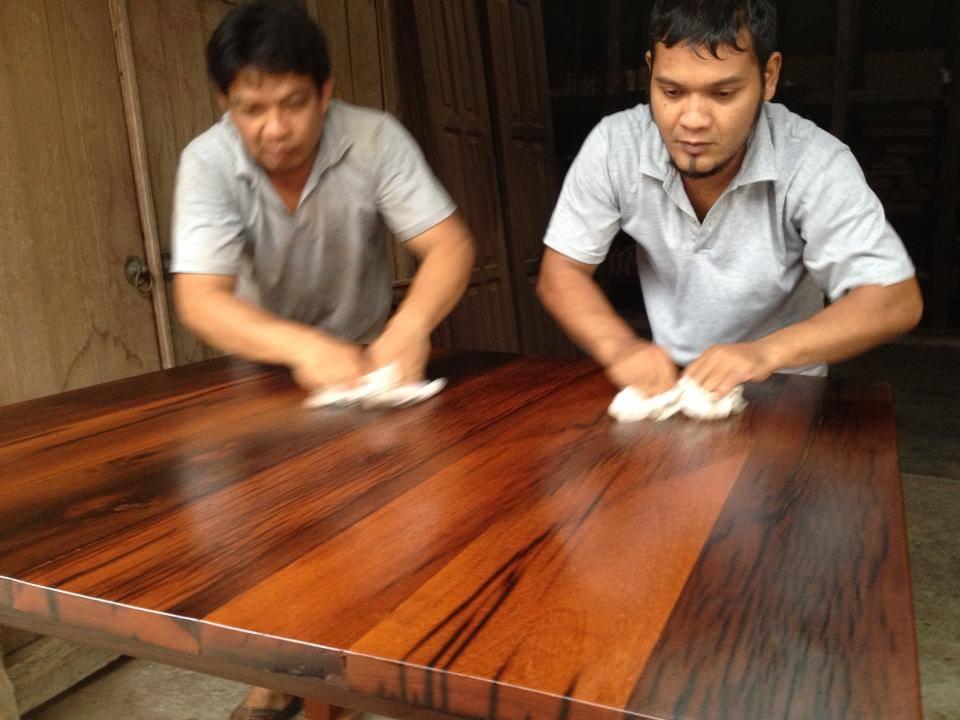 Carpenter applying tung oil on an Ulin countertop