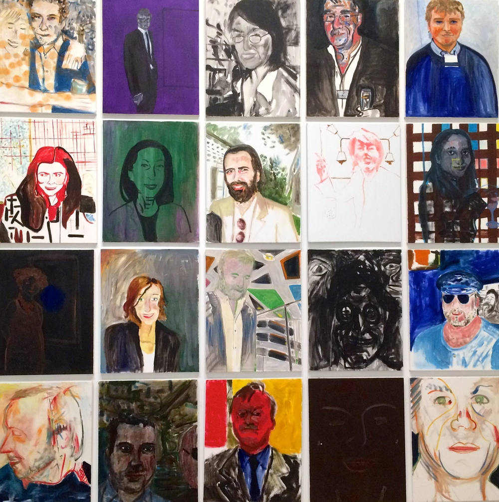 a wall of portraits at the Whitney