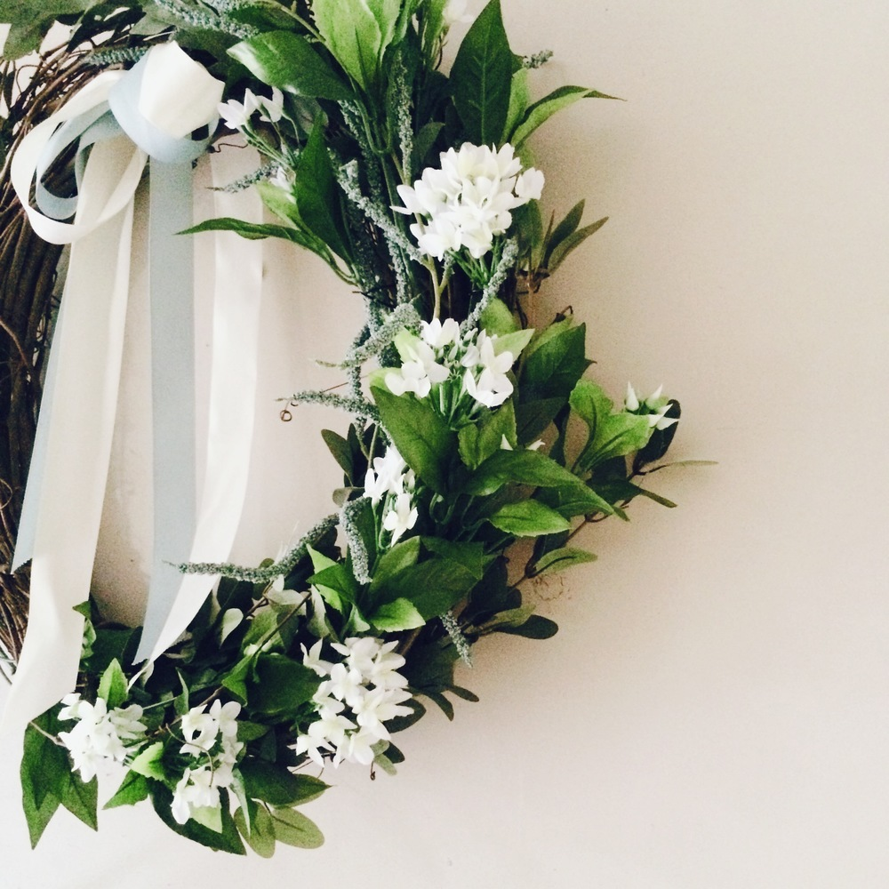 This is a wreath I made myself using silk flowers from Michaels. It hung on my front door from April to October!