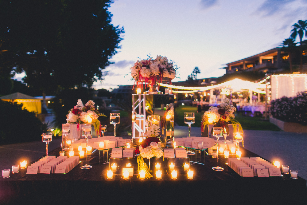 The candlelit escort card table.