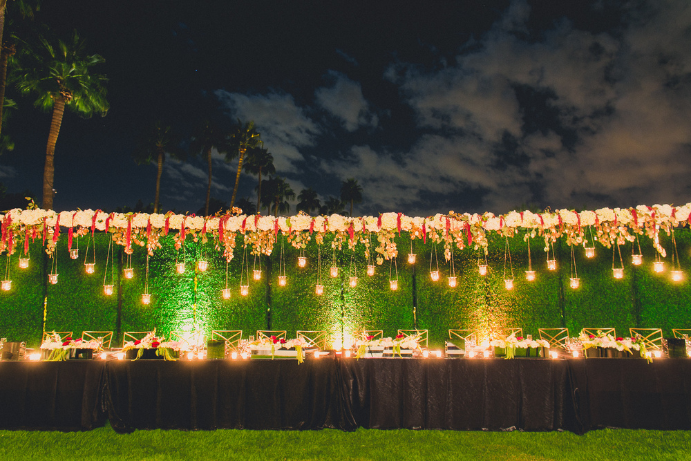 The boxwood hedges created the perfect backdrop to showcase the 32' long suspension.