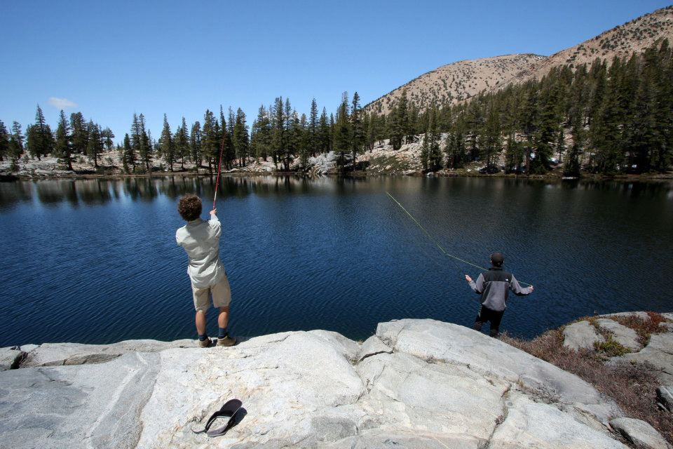 Fly fishing from the rocks above the clear waters