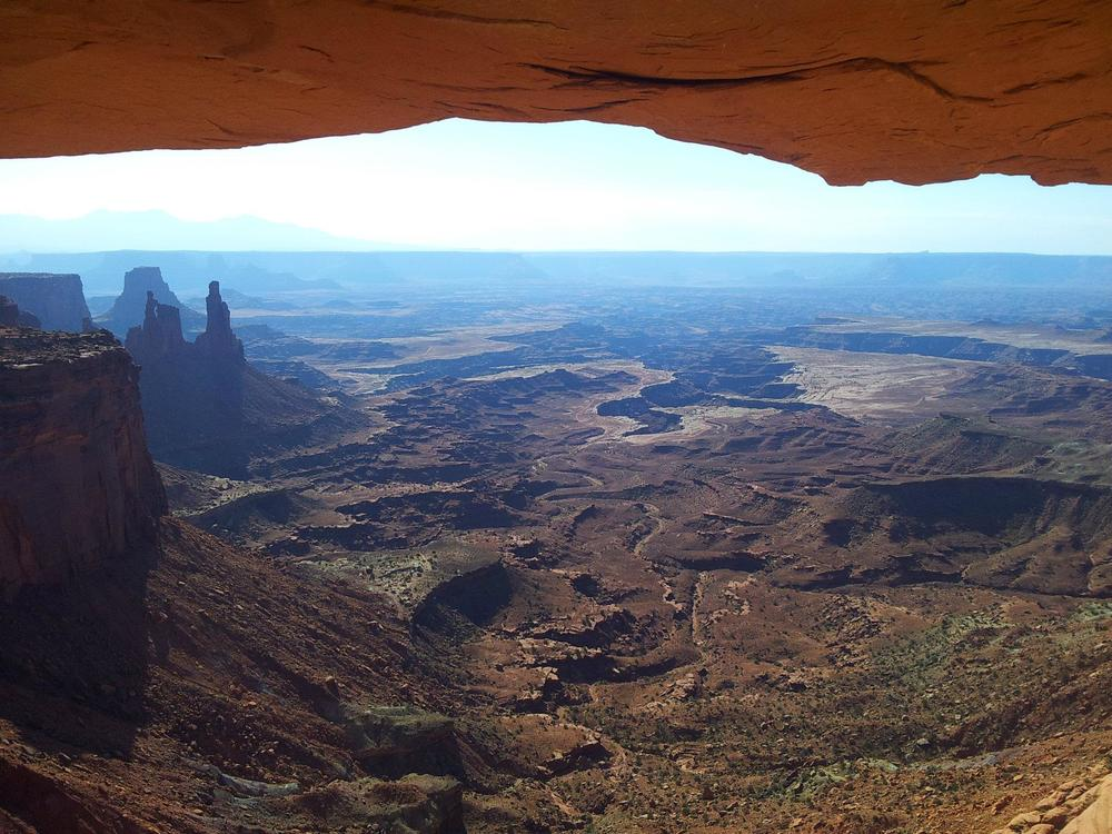 The view of Canyonlands from under the arch