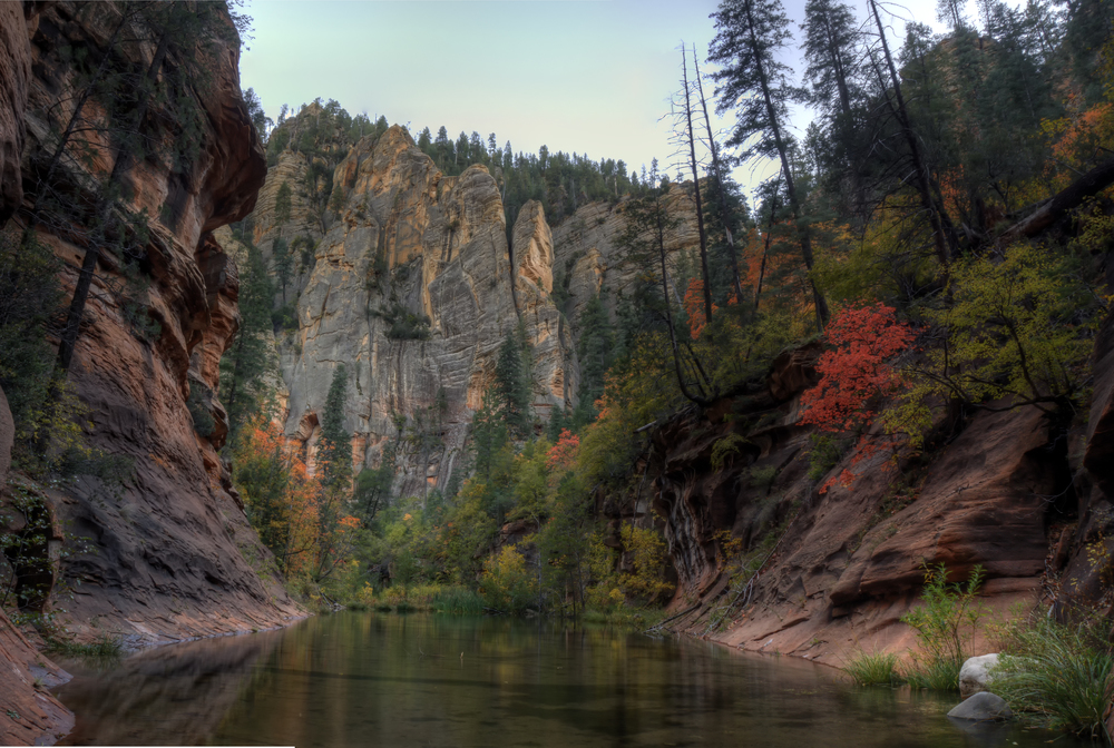 Steep canyon walls and warm colored trees make for a great photo