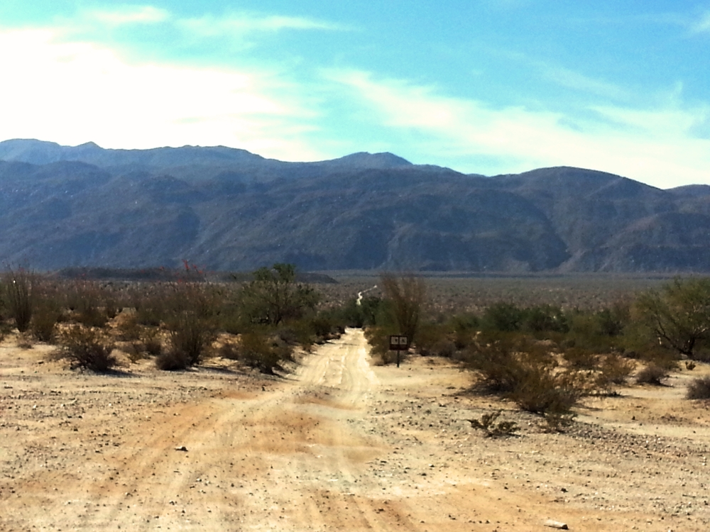 The dirt road with hidden rocks, bumps, and obstacles