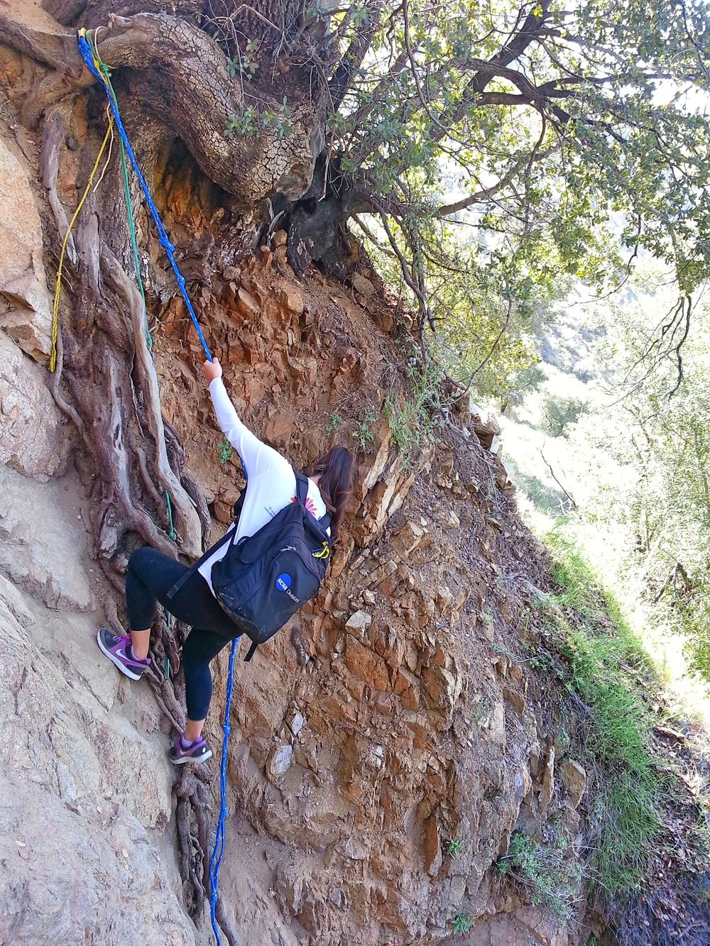Elaine down-climbing a short steep rock section