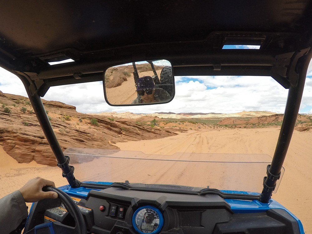 Driving in one of the many sandy washes