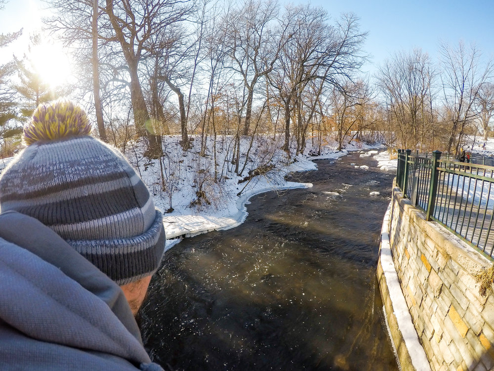 Looking over the calmly-flowing Minnehaha Creek before it cascades over the falls