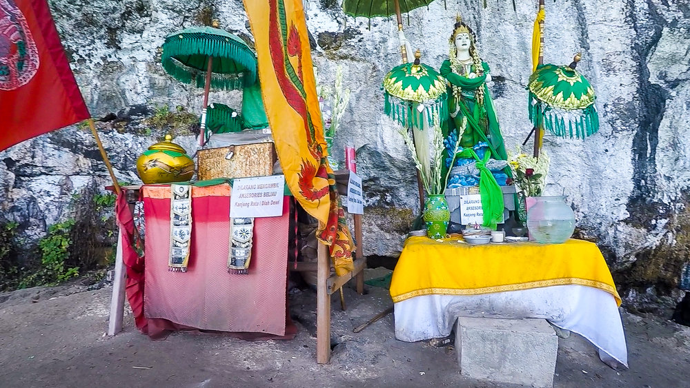 This colorful temple sits nestled on the cliffside surprisingly close to the water's edge