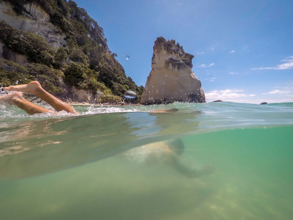 Attempting a split shot in the shallow waters of  Cathedral Cove