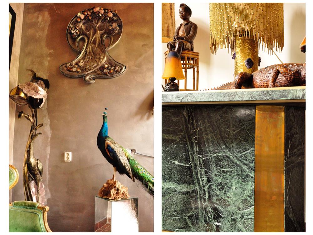 Wandsculpture ontworpen door Marc D'Haenens. De vogellamp links is ook van Marc D'Haenens waarbij het licht door de amethist schijnt. De groen marmeren tafel is van WIlly Rizzo, de gouden lamp is van Henri Fernandez, de sculpture is van Friedrich Goldscheider.