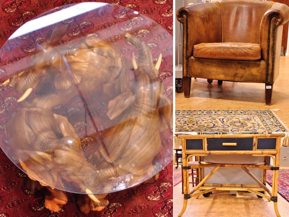 Salontafel met vruchtenhouten voet, bestaande uit 3 olifanten. Richtprijs €250-€300,-. Lederen club fauteuil van Oorschot. €100-€150,-.Rotan bureau (Ik zou het eerder gebruiken als sidetable).Richtprijs €50-€100,-.