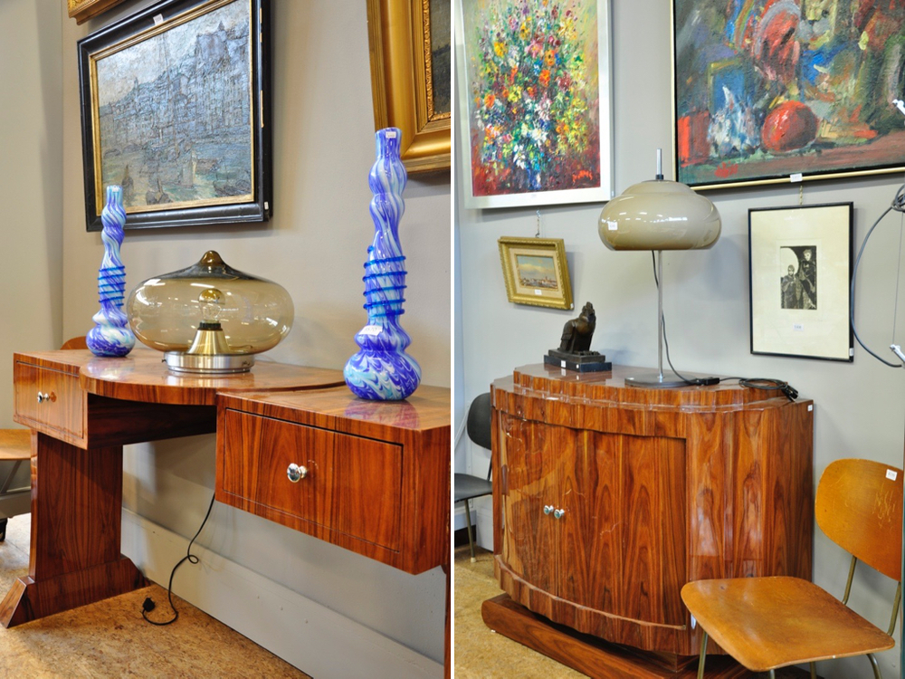 Art deco-stijl bureau, deels mahonie, richtprijs € 400-€ 600. Hanglamp met rookglazen bolkap, à tout prix. Design tafellamp op verchroomde voet,à tout prix. Art deco-stijl wandmeubel € 250-€ 450.