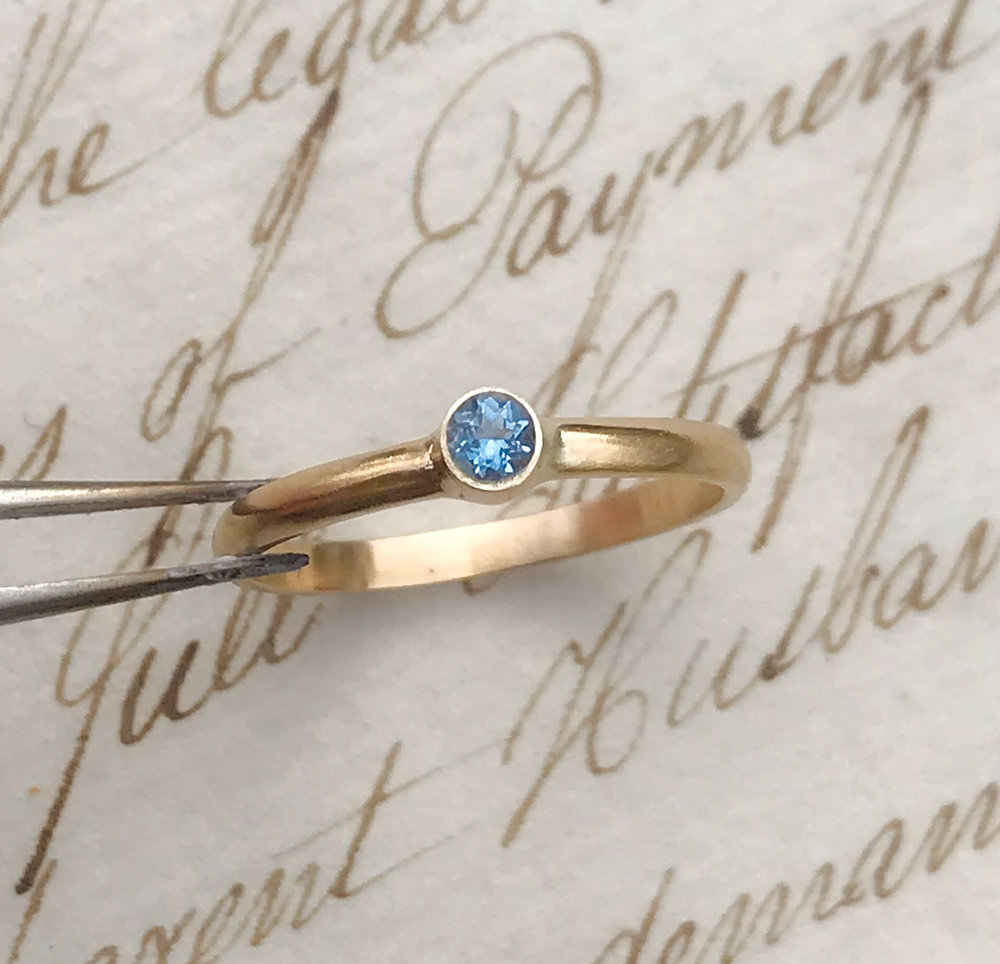 From our new made-to-order   Rainbow Birthstones   collection, a sparkling blue aquamarine (for March) set handmade 9ct yellow gold.