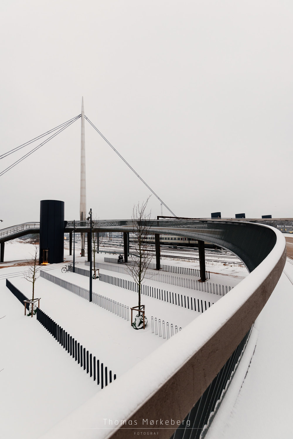 Bicycle parking in snow at Byens bro (bridge) in Odense, Denmark