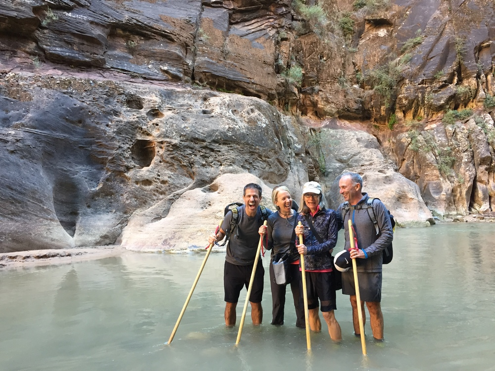 Group of hikers posing in the Zion Narrows.