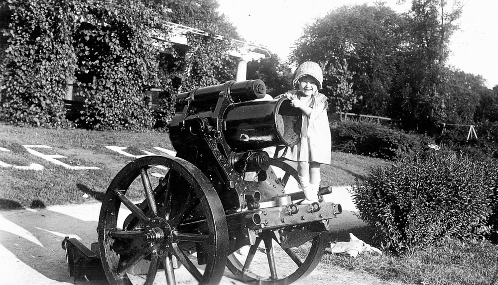 Shirley Steiner, neé Hagen, of the 3800 block of N. Ridgeway, playing on the cannon in Independence Park, circa 1933