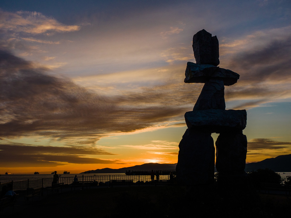 Inukshuk stone sculpture during sunset at Sunset Beach Park