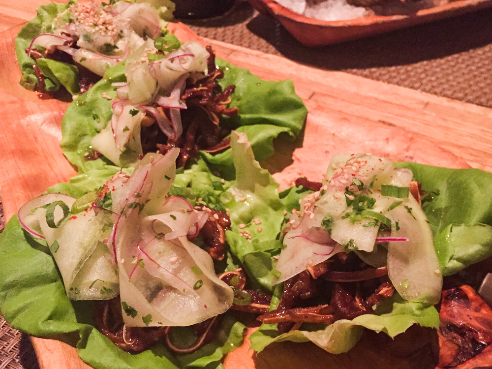 Kentuckyaki — Glazed Pig Ear Lettuce Wraps with Sweet Marinated Cucumber, Red Onion, Sea Island Benne