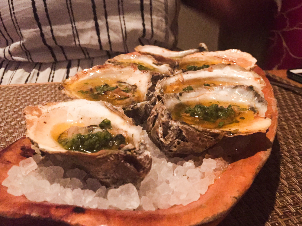 Fire Roasted Sewansecott Oysters, Fried Chicken Fat, Hot Sauce, Honey, Smoked Shishito Peppers