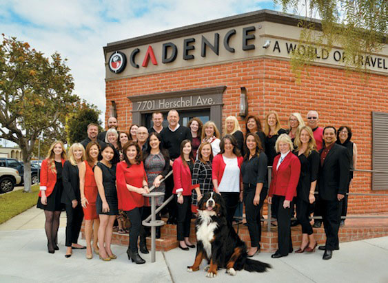 A group of very happy travel specialists in front of the Cadence headquarters in La Jolla, CA.