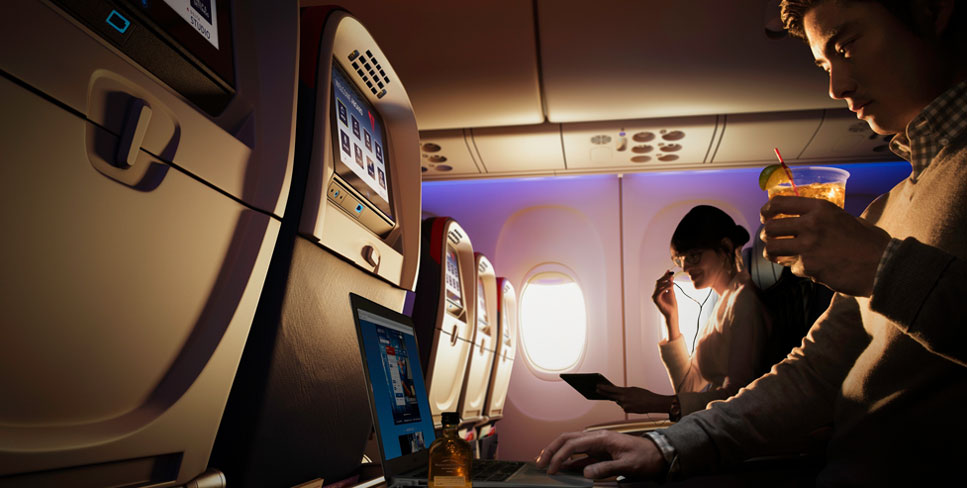 Cheers to the little things in life, like free drinks and extra legroom. Photo Courtesy Delta Airlines.