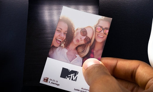 Have your attendees print event photos by hashtagging their selfies