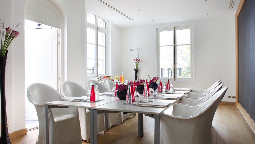 A bright, airy meeting room at Le Royal Monceau - Raffles Paris.