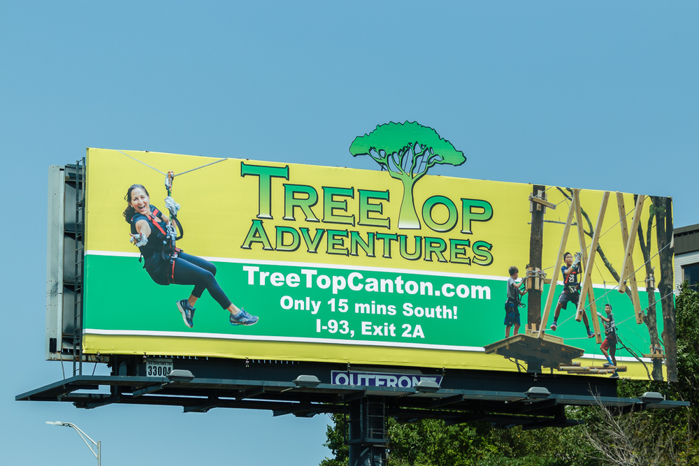 Closeup of the billboard on I-93N Exit 6 in Braintree, MA