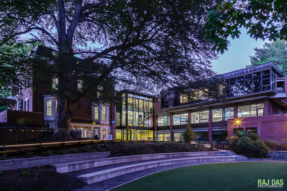 A view of the boardwalk and new foyer of the school building at dusk